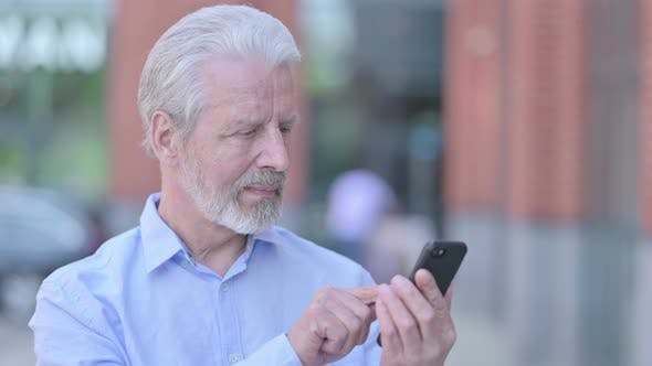Thumbnail for Outdoor Old Man Using Smartphone