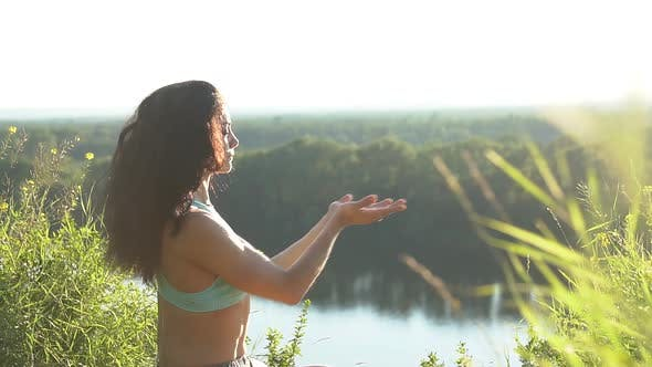 Thumbnail for Healthy Woman Meditating in Pose Lotus Over at Sunset, Slow Motion