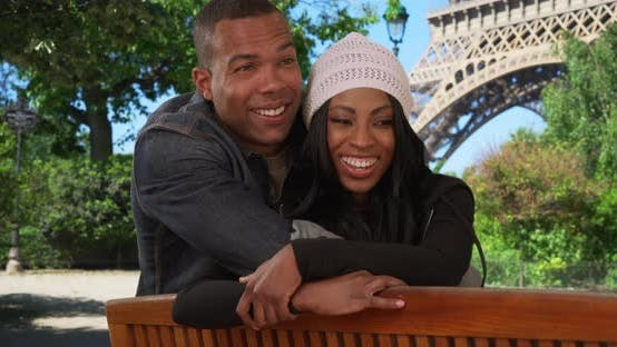 Thumbnail for Happy African man and woman in Paris people-watch near Eiffel Tower