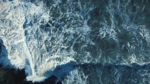 Dramatic Ocean Waves Crashing Slow Motion On Rocks Shot Top Down Drone Angle