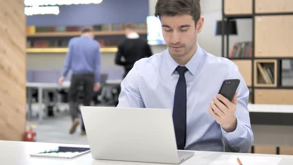 Thumbnail for Businessman at Work Using Smartphone