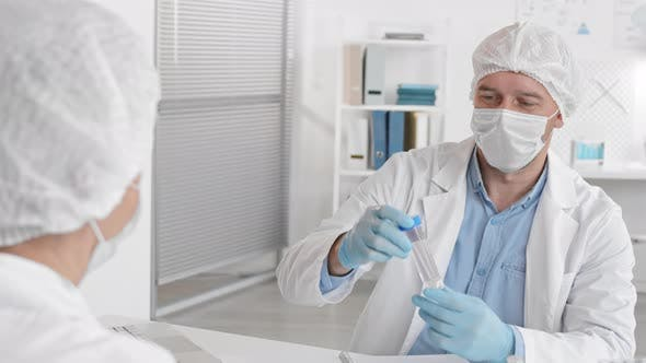 Laboratory Worker with Test Tube