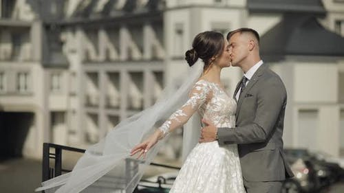 Lovely Newlyweds Caucasian Bride Embracing Groom Making Kiss Wedding Couple Family Hugging Together