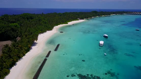 Thumbnail for Beautiful fly over tourism shot of a white sandy paradise beach and blue water background in colourf