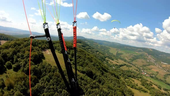 Flying Adrenaline Adventure Paragliding above Green Country in Sunny Summer