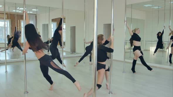 Thumbnail for Group of Hispanic Women Stretching and Warming Up for Their Pole Dancing Class