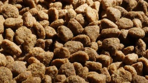Extruded  pellet meal for domestic animals 4K 2160p 30fps UltraHD  tilting footage - Slow tilt on pi