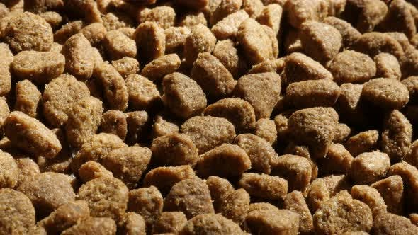 Thumbnail for Extruded  pellet meal for domestic animals 4K 2160p 30fps UltraHD  tilting footage - Slow tilt on pi