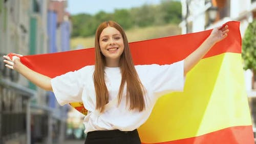 Glad Teenager Female Waving Flag of Spain and Smiling Young, National Holiday