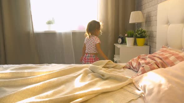 Little Girl In The Bedroom At Home