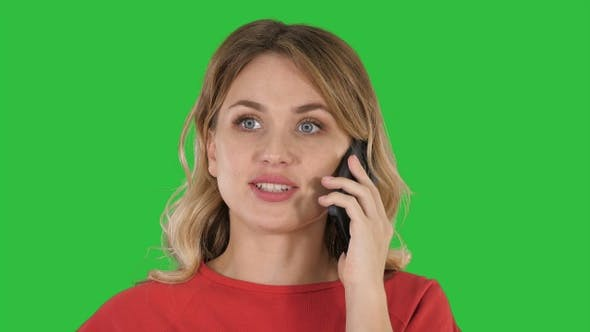 Thumbnail for Happy beautiful girl calling by phone on a Green Screen