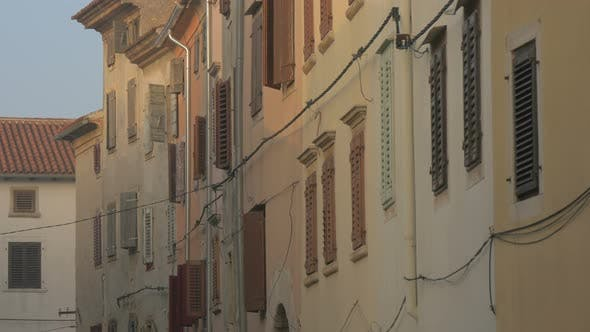 Buildings with window shutters