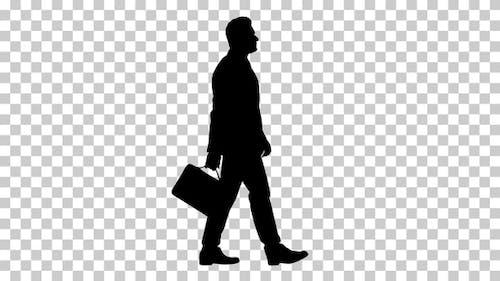 Silhouette  businessman walks , Alpha Channel