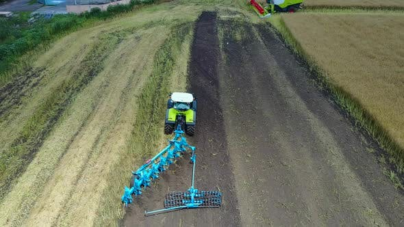 Thumbnail for Tractor Plows the Field