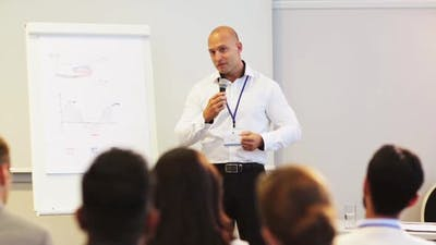 Speaker with Microphone at Business Conference