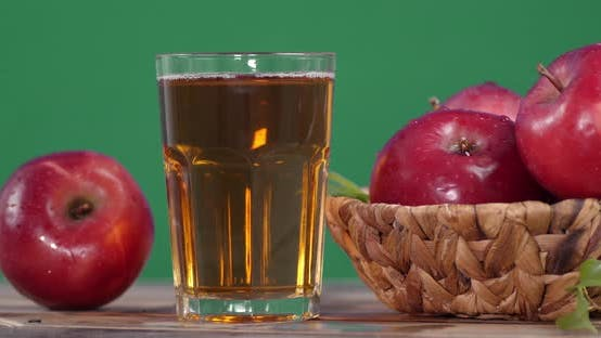 Fresh Apple Juice in the Glass Rotates