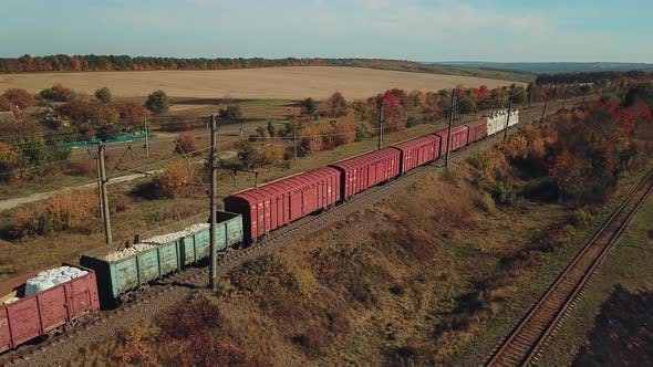 Thumbnail for Freight Train with Building Materials is Passing by Rail to the Destination