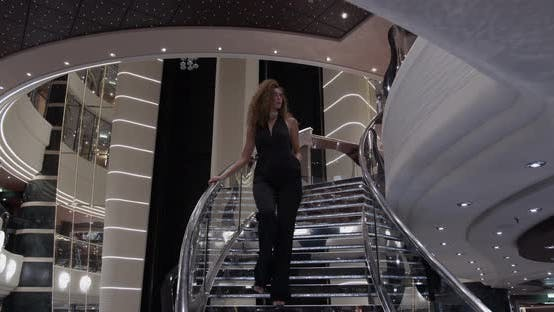 Thumbnail for Beatiful Girl Coming Down the Chic Stairs, Which Shimmers with Precious Stones.