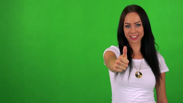 Thumbnail for Young Pretty Woman Shows Thumb Up on Agreement - Green Screen - Studio