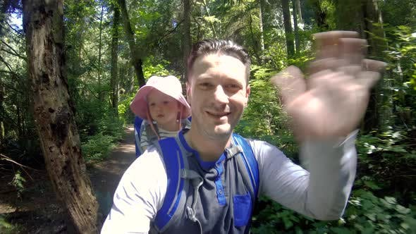 Cover Image for Hiking Selfie Dad And Baby Waving For Social Media Snap