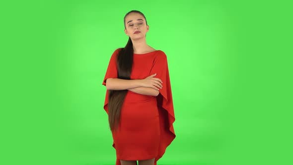 Thumbnail for Pretty Young Woman Is Waiting with Boredom. Green Screen
