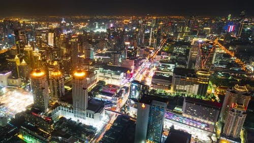 time lapse of Bangkok city downtown and road traffic at night of Thailand , Cityscape