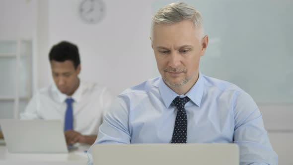 Thumbnail for Thumbs Up By Grey Hair Businessman in Office