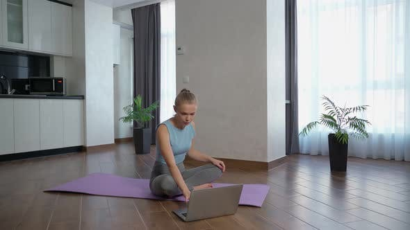 Thumbnail for Sporty Woman Training at Home and Using Laptop