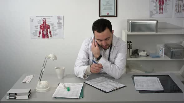 Thumbnail for Doctor at His Workplace and Consulting By Phone