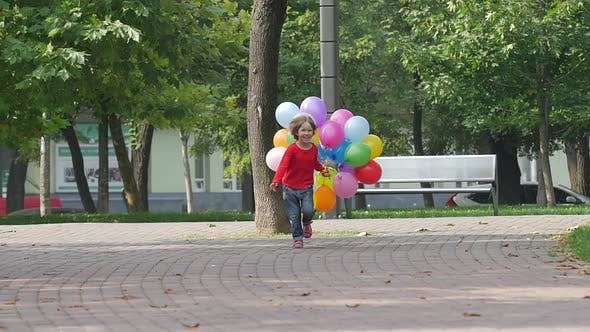 Thumbnail for Little Girl Runs with Multicolored Balloons, Summertime. Slow Motion