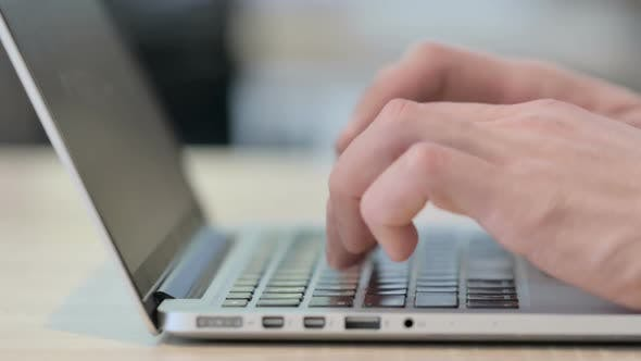 Thumbnail for Close Up of Hands Typing on Laptop Side View