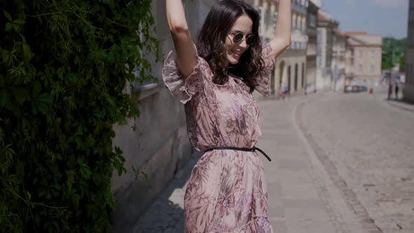 Thumbnail for Fashion Hipster Style Girl Walks Through the Summer City Streets