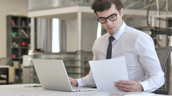 Thumbnail for Businessman Reading Documents