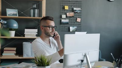 Serious Office Worker Making Mobile Phone Call Talking Working in Office Alone