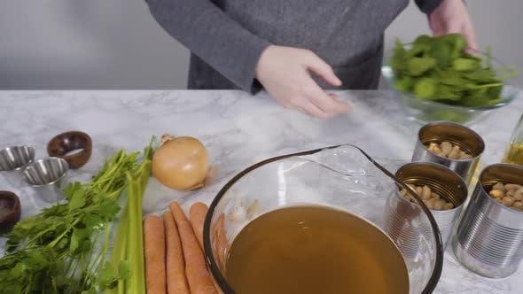 Thumbnail for Ingredients to cook vegetarian white bean soup.