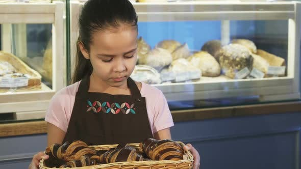 Adorable Little Girl Wearing Apron Working at the Bakery Smiling To the Camera