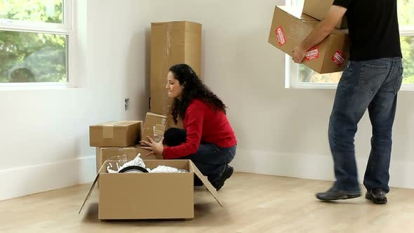 Thumbnail for Couple unpacking boxes