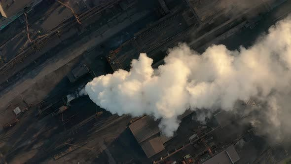 Cover Image for Industrial Zone with a Large Red and White Pipe Thick White Smoke Is Poured From the Factory Pipe in