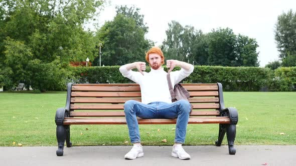 Thumbnail for Both Hands Thumbs Down by Man Sitting on Bench in Park