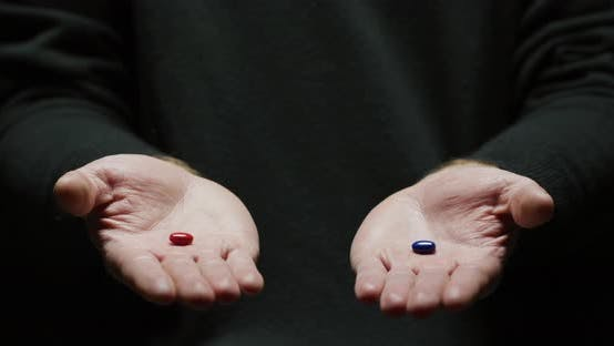 Thumbnail for Hands holding a red and a blue pill