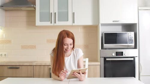 Young Successful Businesswoman Using Tablet at Home Living Room Home Office, Professional Female