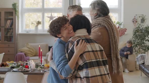 Thumbnail for Happy Couple Welcoming Senior Parents at Christmas