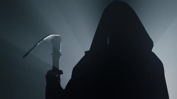 Silhouette Death with Scythe Indoors
