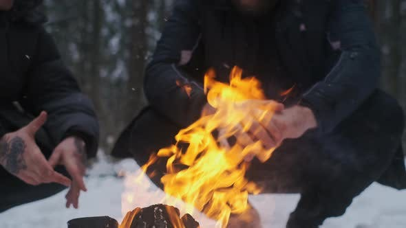 Men Enjoys the Fire at Camping in the Winter Woods Making a Fire Camping in Snowy Forest Men's