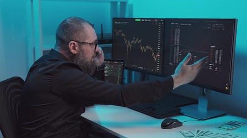 Shocked Businessman Investor at Phone