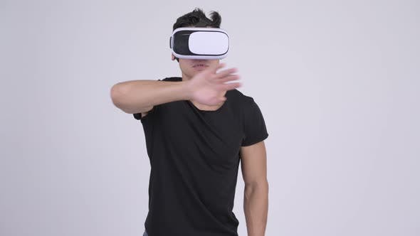 Thumbnail for Young Handsome Multi-ethnic Man Using Virtual Reality Headset