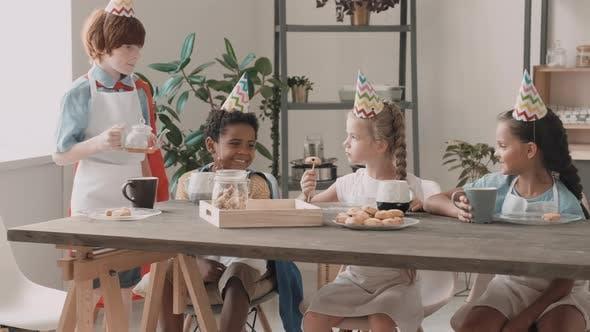 Diverse Kids Having Tea with Cookies