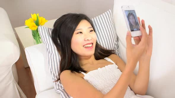 Thumbnail for Asian woman using her phone to take pictures