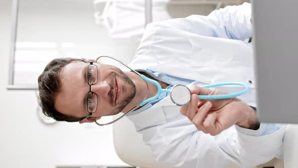 Portrait of Handsome Doctor with Stethoscope