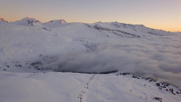 Thumbnail for Aerial Revealing Shot Of A Ski Resort In Switzerland During Sunrise